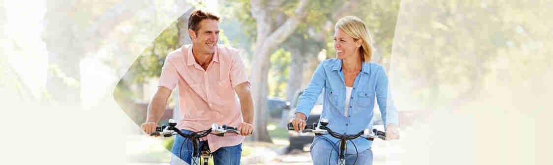 Couple happily biking together