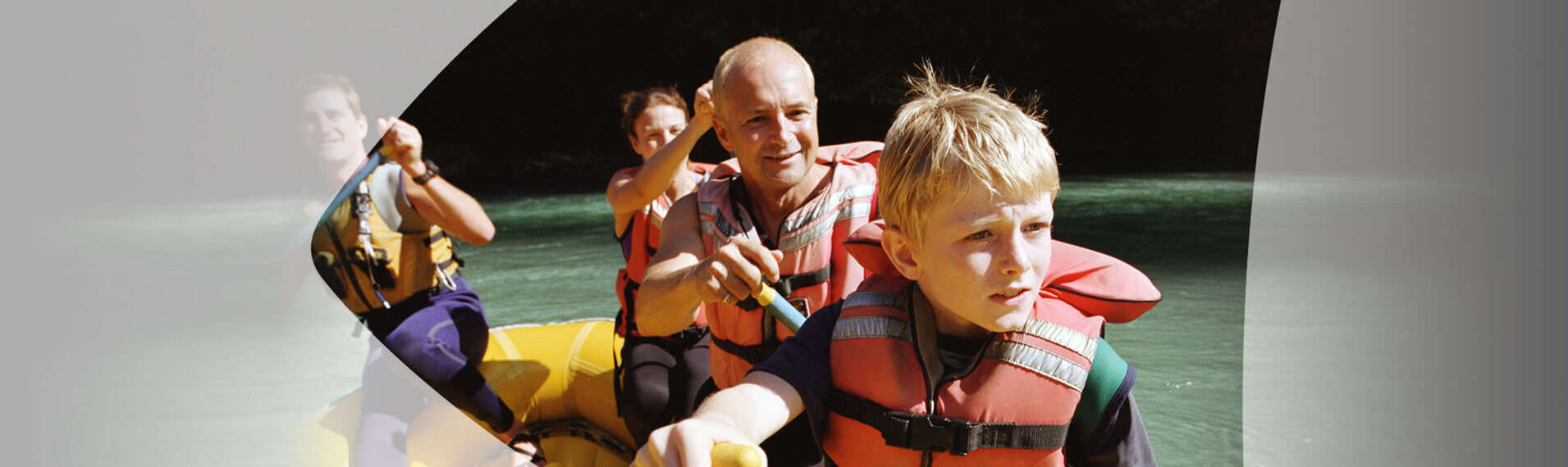 Family paddling on a raft