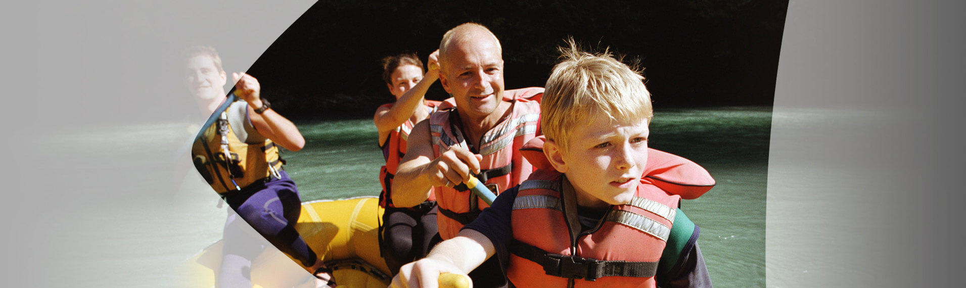 Family Paddling a Raft