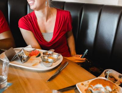 Woman Holding her Nicorette QuickMist in a Restaurant