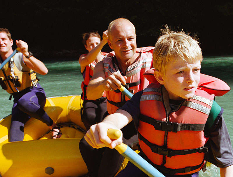 Family rafting on a river